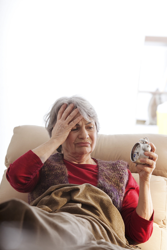 Elderly Woman with Hand on Head Looking Distressed